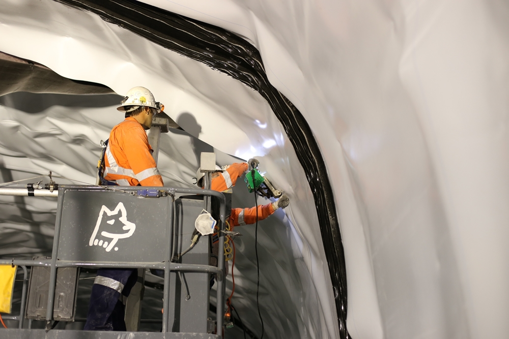 The tunnel environment is often busy with tools, equipment and vehicles.