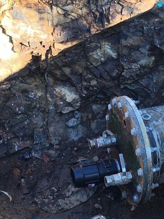 Filling a redundant pipe under Bootawa Dam.